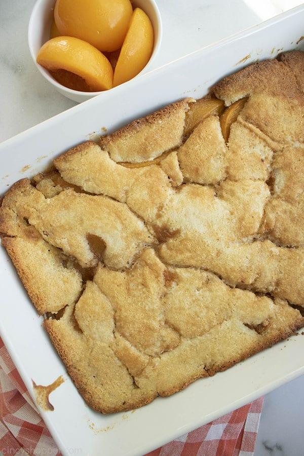 Fresh Baked Easy Peach Cobbler in a white baking dish.