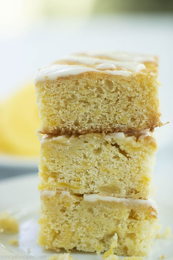 Stack of three dessert bars with pineapple