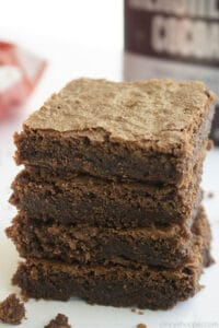 stack of Hershey brownies next to box of Hershey's cocoa powder