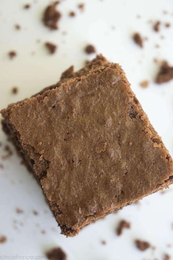 single brownie surrounded by brownie crumbs
