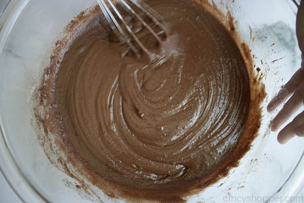 whisking chocolate in a bowl