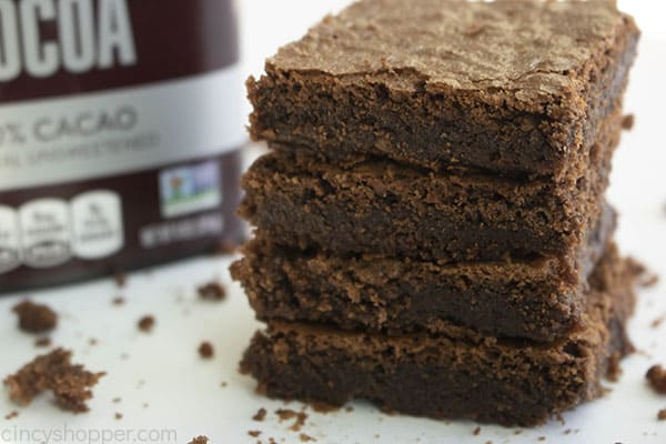 stack of 4 Hershey cocoa brownies next to a box of Hershey's cocoa powder