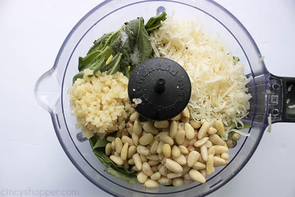 basil, garlic, pine nuts, and Parmesan in a food processor