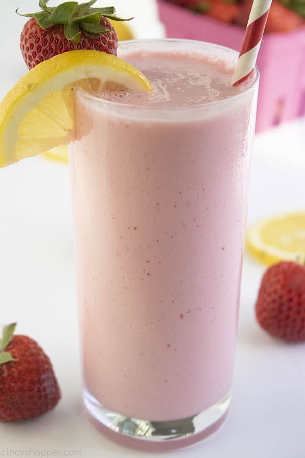 Strawberry Lemonade frosted version in a tall clear glass.