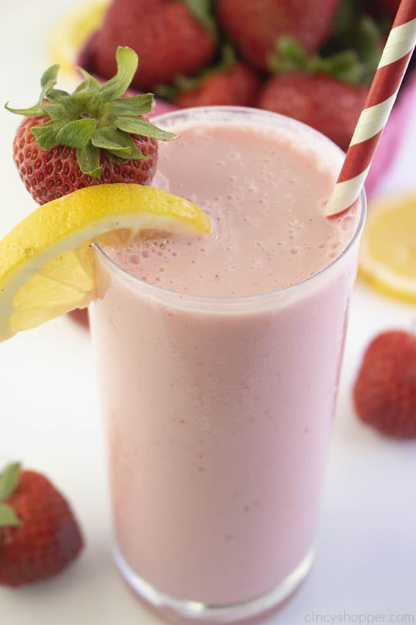 Tall glass with pink colored frosted strawberry lemonade