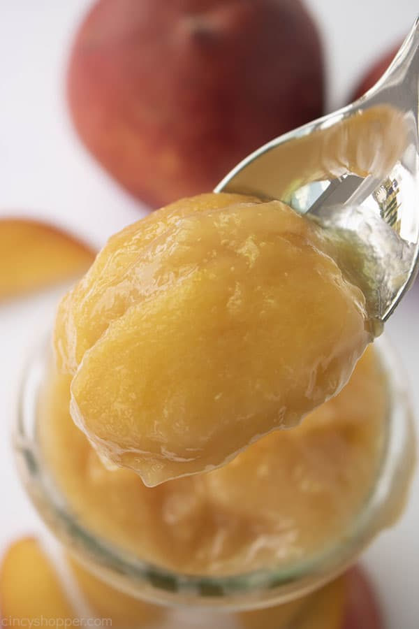 Homemade Peach Pie filling on a spoon