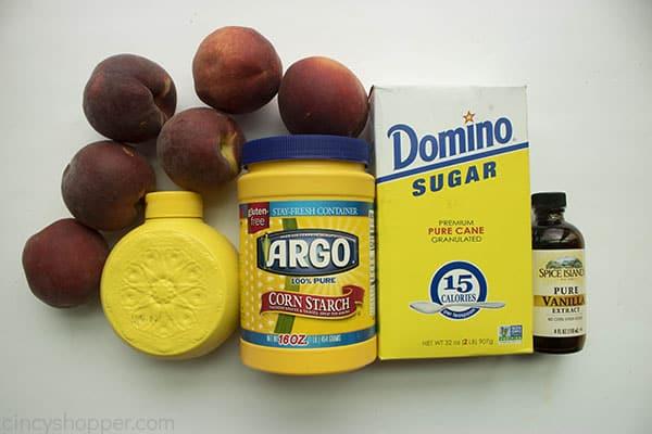 Ingredients to make Peach filling. Fresh peaches, sugar, cornstarch, vanilla, lemon juice.