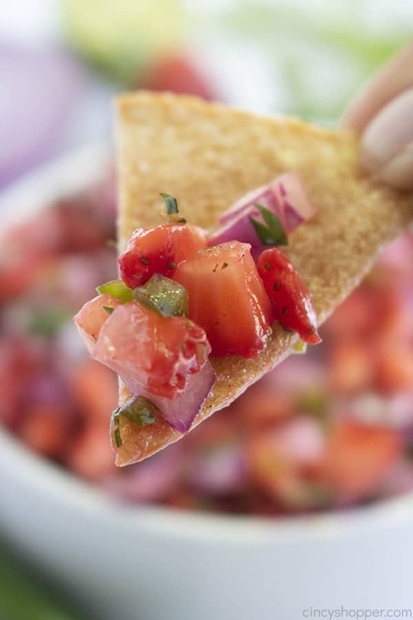 Close shot of easy salsa on tortilla chip