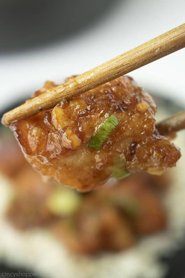 General Tso's Chicken between two chopsticks.