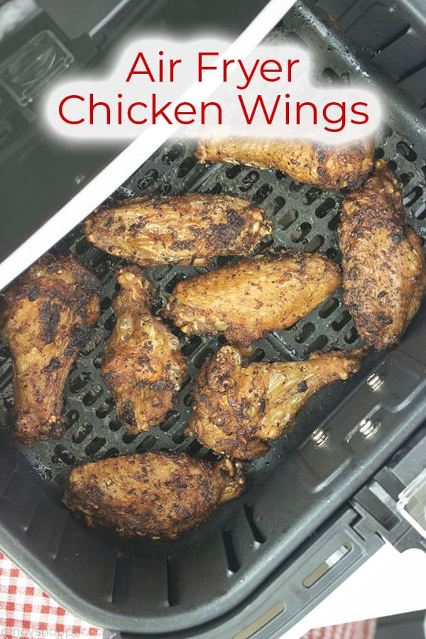 Cooked wings in air fryer with text on image Air Fryer Chicken Wings