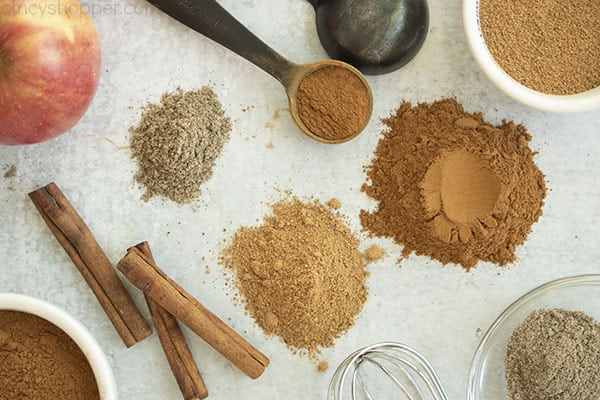 Homemade Apple Pie Spice with ingredients on a gray background