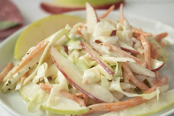 Horizontal image of creamy apple slaw on a white plate