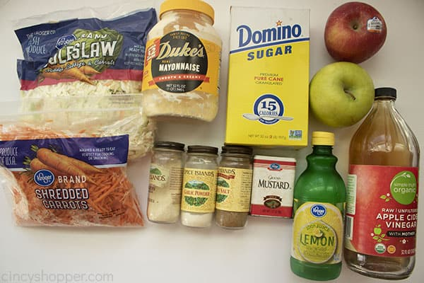 Ingredients for apple slaw salad on a white background