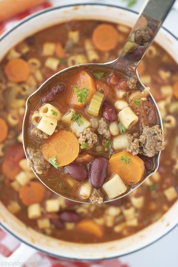 Pasta Fagioli soup in a ladle overhead shot