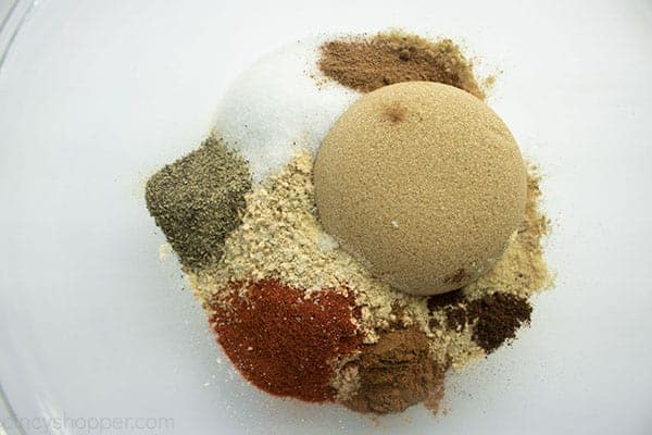 Overhead photo of all the dry ingredients in a large clear bowl