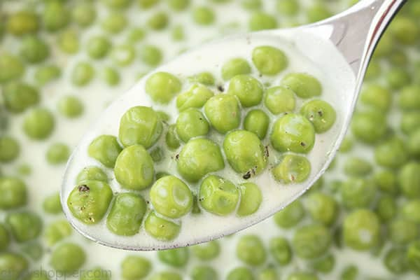 Creamed peas on a spoon