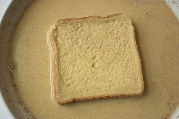 Texas Toast in egg mixture