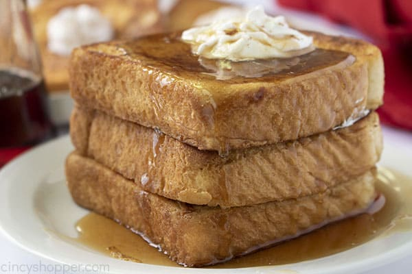 Stack of French Toast on a plate with butter and syrup