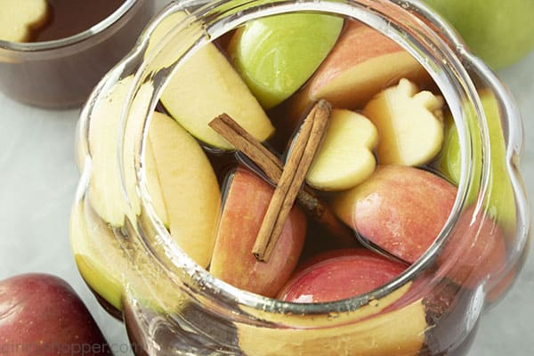 Apple cider in a clear punch bowl