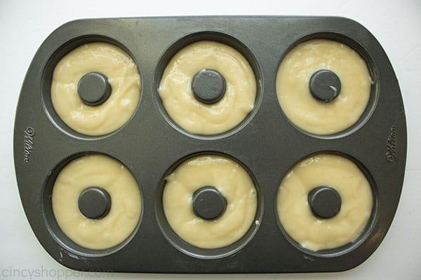 Unbaked batter in donut pan.
