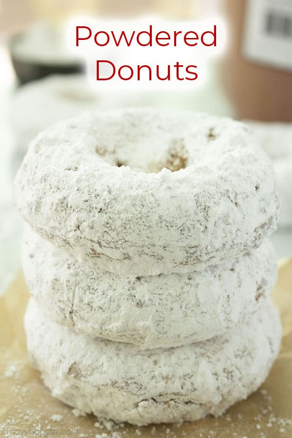 Stack of donuts with text on image Powdered Donuts.
