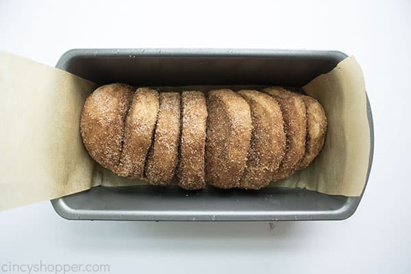 Cinnamon bread in a loaf pan with paper