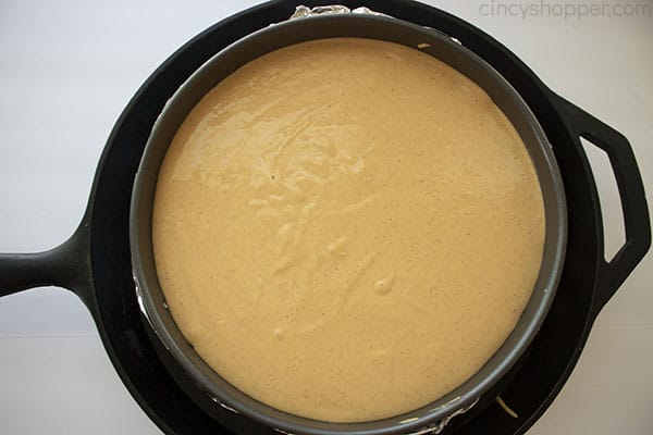 Cheesecake inside of a skillet for water bath