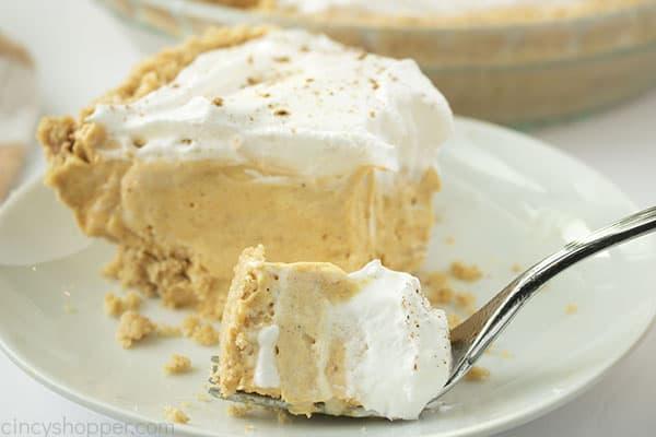 Fluffy pumpkin pie on a fork
