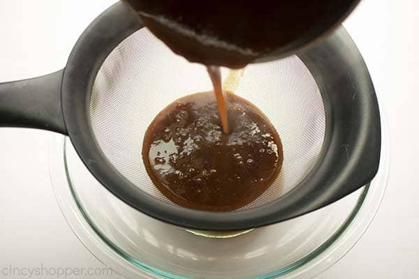 Straining pumpkin spice syrup