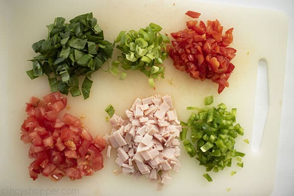 Diced meat and veggies for muffins