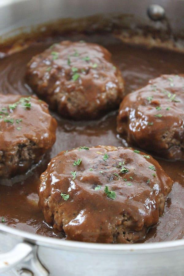 Salisbury Steaks in a pan with gravy
