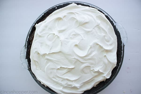 Whipped topping added to pudding layer