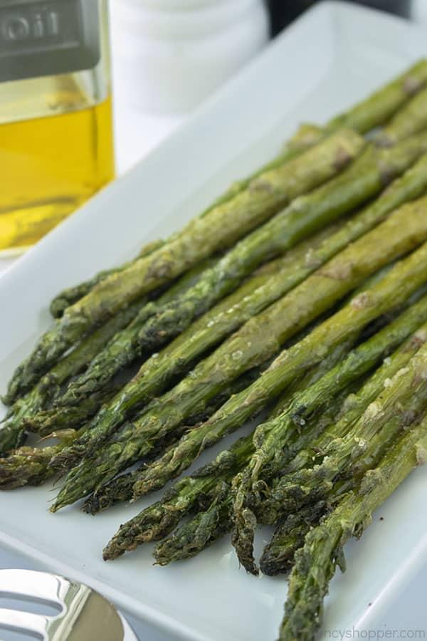 Air Fryer roasted asparagus on a platter