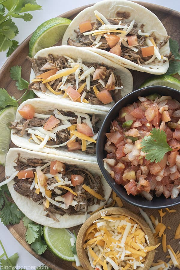 Slow Cooked Barbacoa meat on tacos with toppings