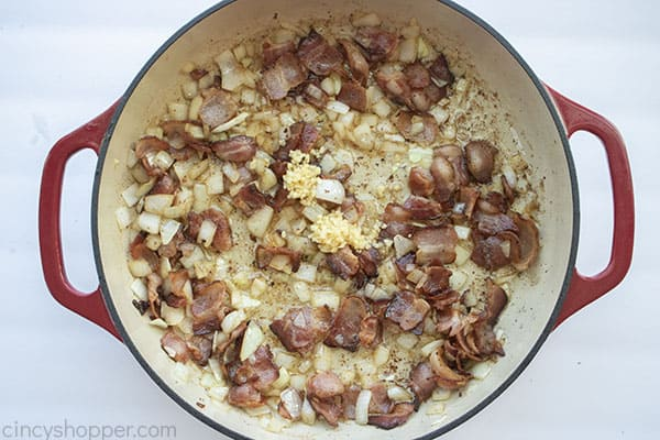 Garlic added to bacon and onions