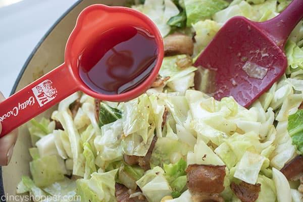 Red wine vinegar added to cabbage