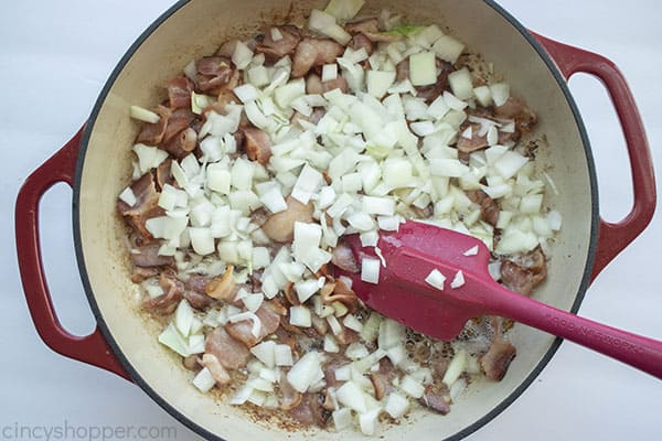 Onions added to bacon in pan