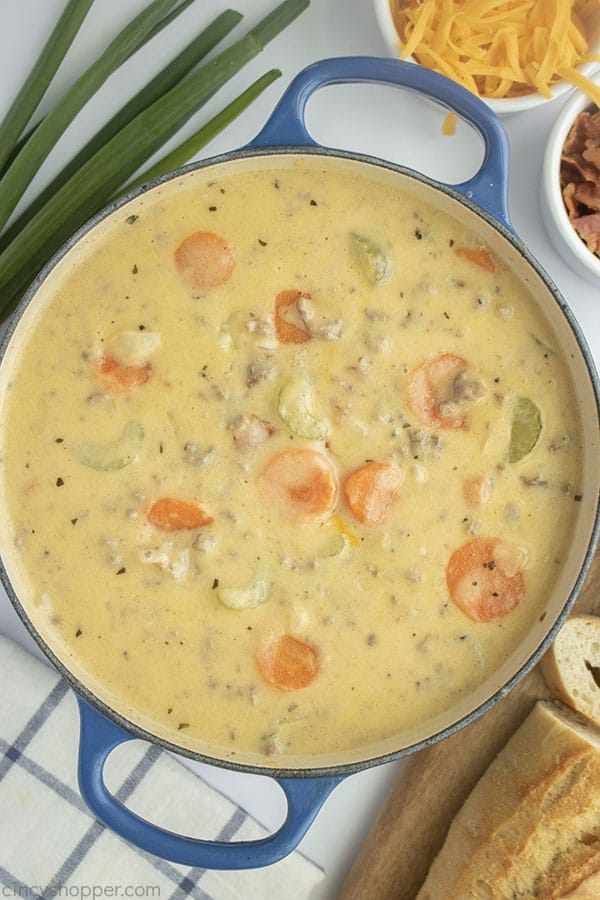 Creamy Cheeseburger Soup with vegetables in a pot