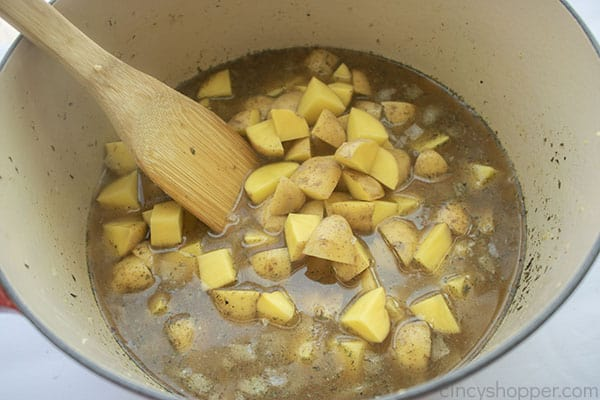 Potatoes added to pot
