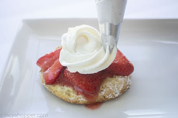 Whipped topping added to strawberries