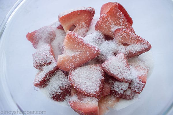 Sugar added to strawberrie sin a bowl