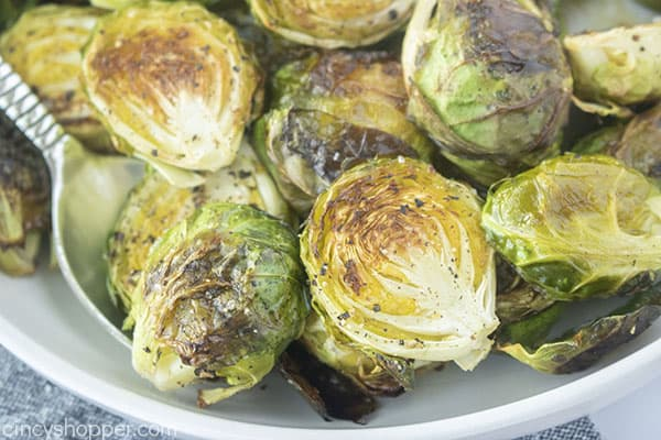 Oven Brussel Sprouts in a bowl with a spoon