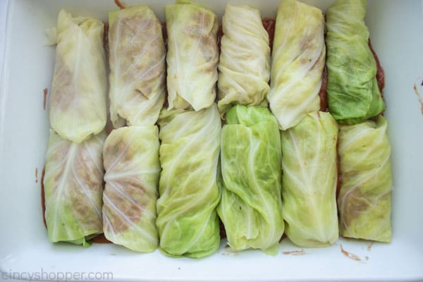 Filling added to cabbage and rolled in a baking dish
