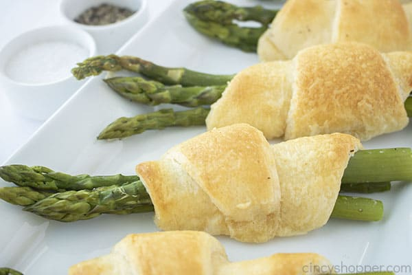 Wrapped asparagus on a platter