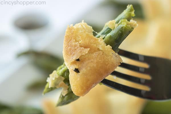 Pastry asparagus on a fork