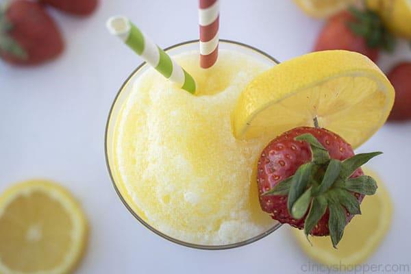 Frozen lemonade with fresh lemon and strawberries