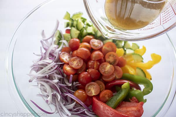 Greek dressing added to salad