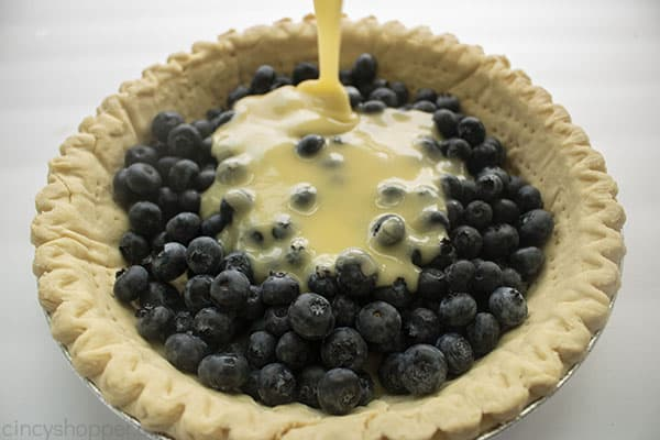 Custard added to blueberries in pie shell