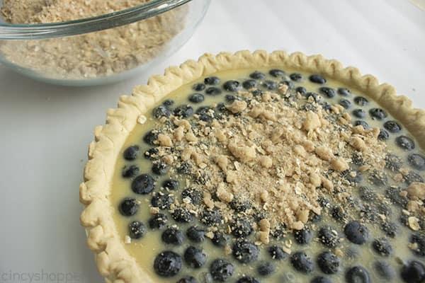 Adding crumble to blueberry pie