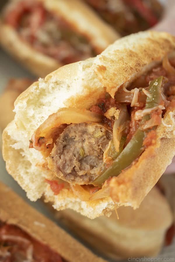 Sausage with peppers and onions on a hoagie roll